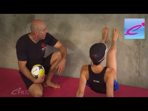 Exercise at home against a wall with Primal Movements routines from Tuff Mumma