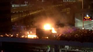 Hong Kong police vehicle bursts into flames after being hit by Molotov cocktail