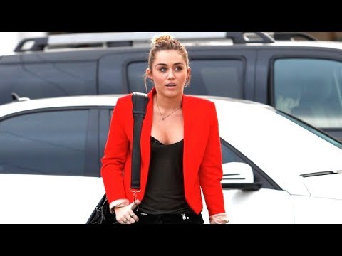Miley Cyrus Goes Shopping In Low-Cut Top And Red Jacket ...