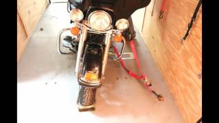 How to transport a motorcycle with straps and a wheel chock