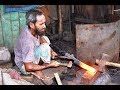 Chapati & Knife maker in karwan bazar of Dhaka in bangladesh. (churii, chapati, da)