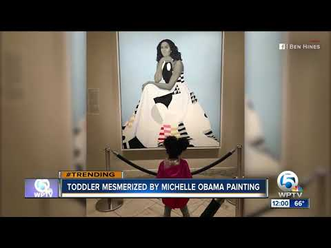 Toddler mesmerized by Michelle Obama portrait