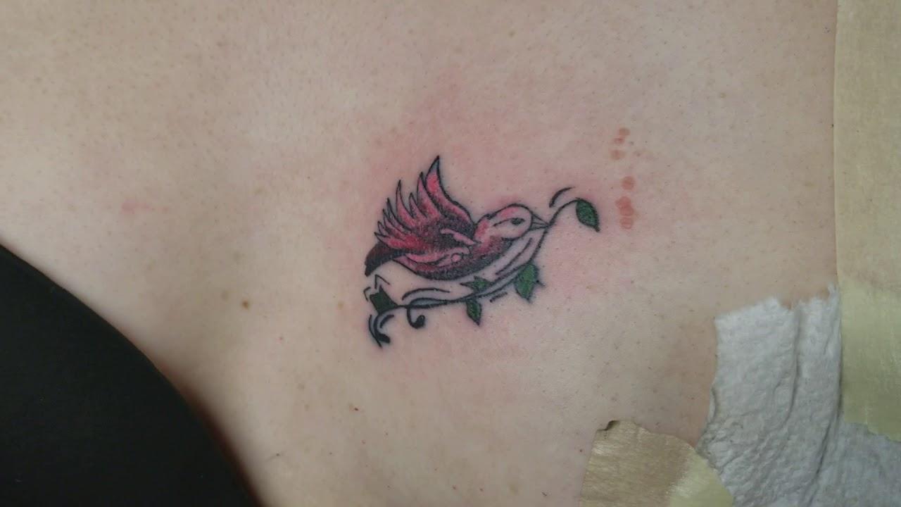 Small Bird On Female Left Breast Tattoo By Boris Kuryakin March 28