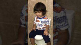 Singing in the Bathroom while Getting the Hang of his Potty.