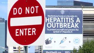 Giant banner in uptown Charlotte raising attention on Hepatitis A outbreak
