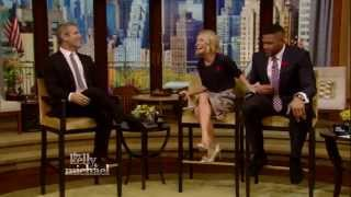 "Andy Cohen ""Punches"" Michael Strahan"