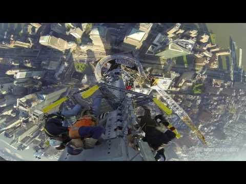 Workers install final section of spire atop One World Trade Center