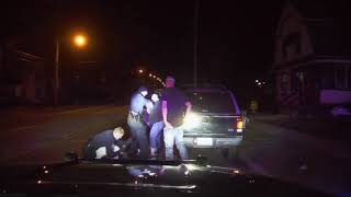 Dashcam video shows officers arresting man while others interfere