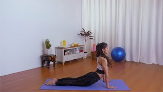 Flexible Indian girl practicing morning yoga postures on a mat - healthy lifestyle