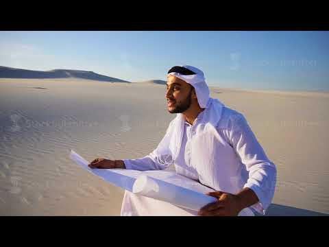Enterprising male sheikh businessman sitting with white paper in hands and thinking of ideas for new