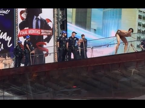 Naked Donald Trump protester, model Krit McClean Times Square New York jumps from TKTS booth