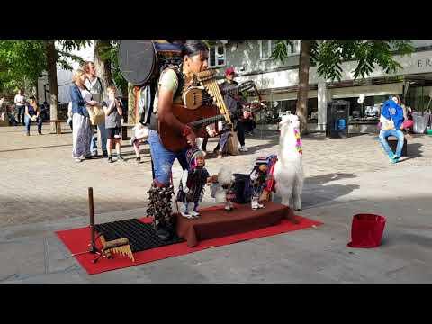 Peruvian One Man Band Busker & Puppet pan flute  real talent addictive  El Cóndor pasa