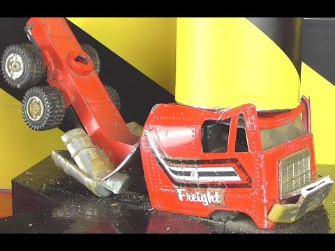 Experiment Crushing  some toys with hydraulic press