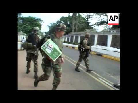 US marines guard embassy in tense capital - YouTube