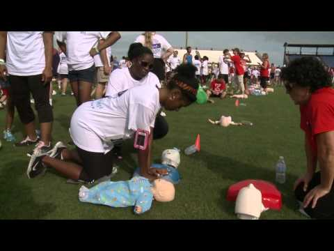 Record-setting 5000 people learning CPR in a stadium field.