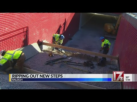 Crews rip out steps leading to new pedestrian tunnel near NC State