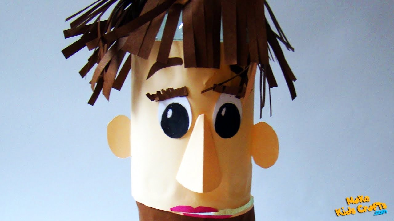 The Praxis 2020 Mascot: a paper puppet with brown bangs and dark eyes