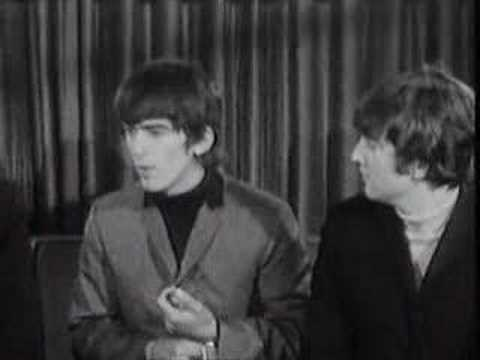 John thinks of the name Beatles