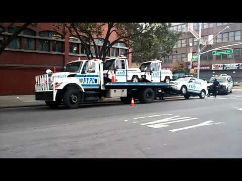 NYPD Field Support Division Tow Truck Loaded With Busted NYPD Cars In Need Of Repairs In The BX