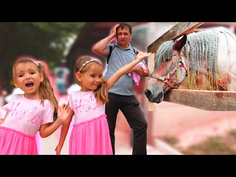 Папа и девочки играют на ферме