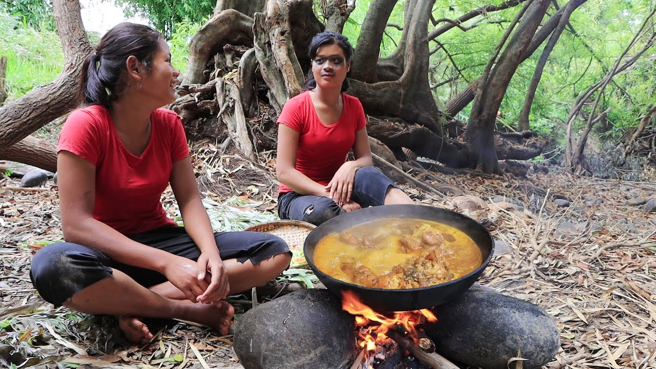 Survival cooking in the rainforest: Yummy cook Pig legs spicy tasty Braised for Eating delicious