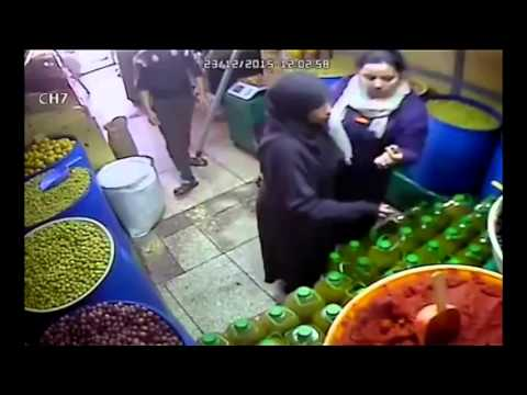 LiveLeak - Woman tries to steal an oil jug and put it between her legs