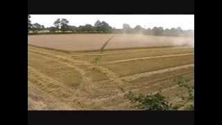 New Holland Combining Time Lapse 2012 Wheat Feild