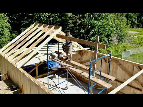 this-made-my-toes-tingle!-one-man-attempts-to-install-ridge-pole-and-rafters-on-post-and-beam-barn