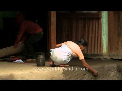 Manipuri woman cleaning house in the morning