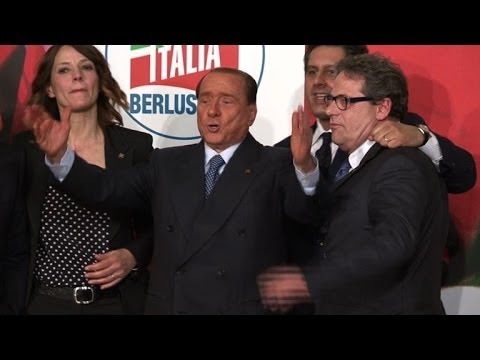 Berlusconi 'pleased' to do community service with needy