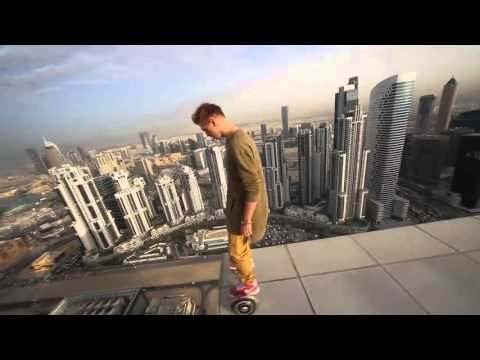 Riding a hoverboard on a rooftop