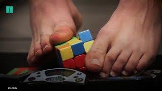 Teen Solves Rubik's Cube With His Feet