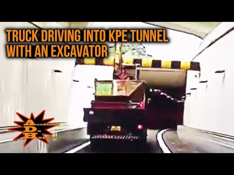 Truck Driving into KPE Tunnel with An Excavator