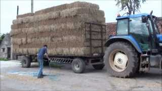 unloading wheat straw small bales