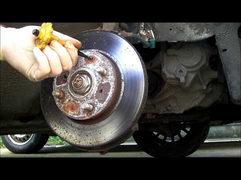 How to remove rusted seized brake rotor screws