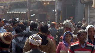 Indian population walking around in the crowded streets of a market in India