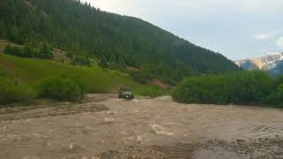 Jeep JK Wrangler Unlimited river crossing with M416 off-road trailer
