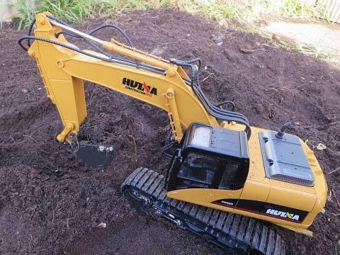 Digging a hole in garden with RC Digger
