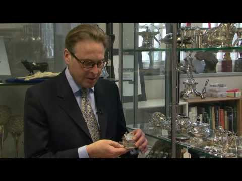 Looking at antique silver trinkets