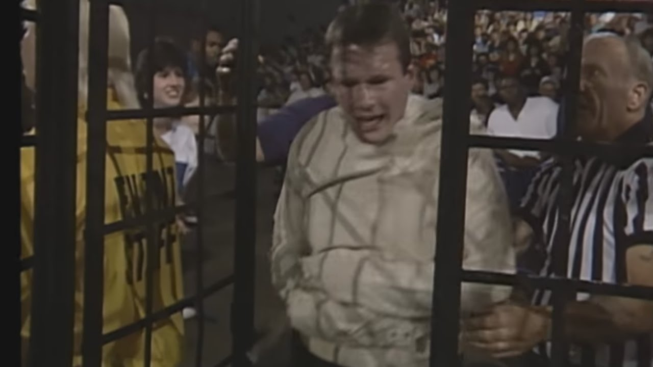 Jim Cornette is suspended above the ring in a cage: Great American Bash 1988
