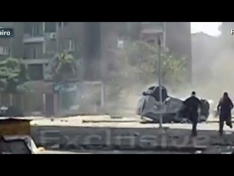 Egyptian police vehicle pushed off bridge in Cairo