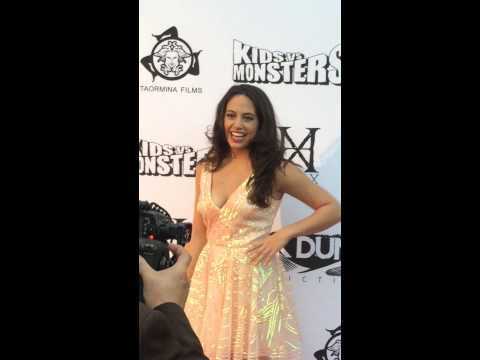 Actress Taylor Stammen walks the red carpet at the premiere of Kids vs Monsters, Egyptian T 92815.