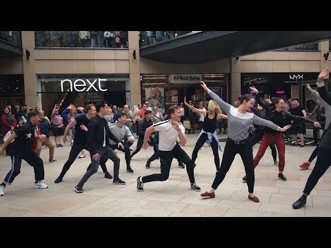 Shoppers get an all-singing all dancing surprise... and it's Too Darn Hot!