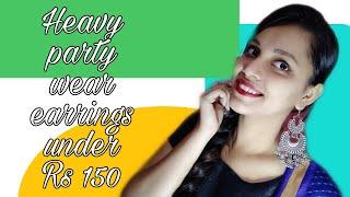 Heavy party wear earrings unde…
