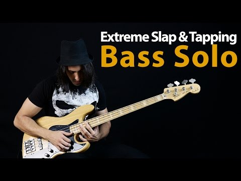 Download Youtube: Extreme Slap & Tapping Bass Solo by Miki Santamaria (The Bass Wizard)