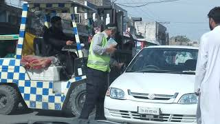 Mardan traffic police moving a police car to the right parking, best work,