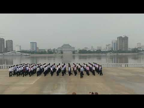 Marching at the Juche Tower, North Korea