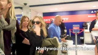 Chloe Grace Moretz greets fans arriving back from Salt Lake City at LAX aiport in LA