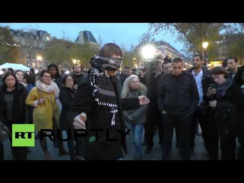 France: Blindfolded Muslim man hugs mourners in Paris