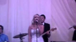 Bride Jenny Gilbert sings at wedding